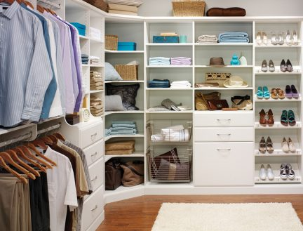 white custom wardrobe with shoe racks and shelving